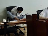 Armless man sits postgraduate entrance exams, writing with foot